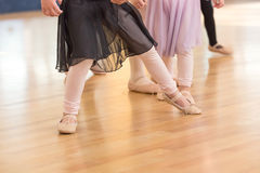 Creative Ballet Close Up Little Girls'outstretched leg in ballet class. Creative Ballet Close Up Little Girls' Feet, Stocking Legs, ballet slippers, Hands Stock Photo
