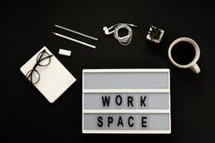 Creative black desktop laptop, coffee, glasses, headphones, pencils, workspace words. Stock Photos