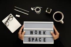 Creative black desktop laptop, coffee, glasses, headphones, pencils, workspace words. Royalty Free Stock Photos