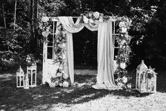 Creative black and white photography. Black and white art photography monochrome, beautiful wedding ceremony outdoors. Wedding arch made of cloth and white Royalty Free Stock Images