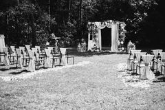 Creative black and white photography. Black and white art photography monochrome, beautiful wedding ceremony outdoors. Wedding arch made of cloth and white Stock Images