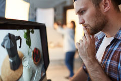 Creative blogger. Pensive food-blogger in front of monitor stock photo
