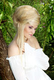Creative blond  hairstyle of beautiful woman Royalty Free Stock Image