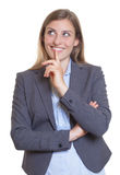 Creative blonde businesswoman in a grey blazer Royalty Free Stock Photography