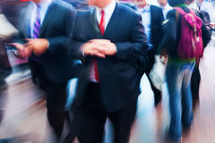 Creative blurred picture of businessmen on the move Stock Photo