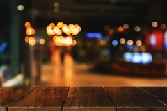 Creative blurry texture. With wooden desk and blurred cafe or restaurant interior. Mock up Royalty Free Stock Images
