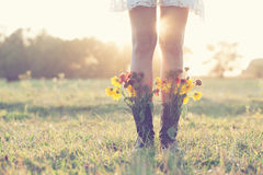 Creative bouquet in boots. Creative bouquet in female boots Royalty Free Stock Photos