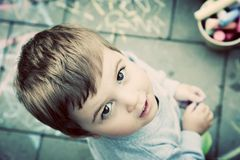 Creative boy painting on floor. Learn and play, vintage. Stock Image