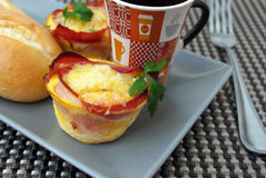 Creative breakfast – egg muffins with bacon, coffee, white bread, butter Stock Images