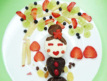 Creative breakfast with fruit and sweet chocolate creme on bread Royalty Free Stock Image