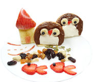 Creative breakfast with fruit and sweet chocolate creme on bread Royalty Free Stock Photos