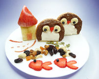 Creative breakfast with fruit and sweet chocolate creme on bread Stock Photo
