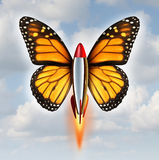 Creative Breakthrough. Business metaphor as a rocket with monarch butterfly wings blasting off to higher levels of success as a symbol of the power and speed of Royalty Free Stock Images