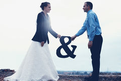 Creative bride and groom couple standing on roof Stock Photography