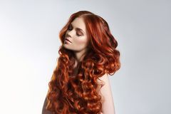 Creative bright coloring of a woman`s hair, careful care of the hair roots. Bright dye for coloring, long strong hair. Natural