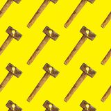 Creative bright seamless pattern of glass bulbs and hammer on yellow background stock photos