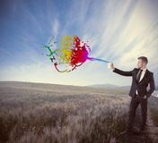 Creative in business. Concept with businessman and spry Stock Image