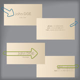 Creative business cards with arrow binder clips Royalty Free Stock Photography