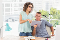 Creative business colleagues using a digital tablet Royalty Free Stock Image
