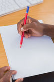 Creative business employee drawing something Stock Photography