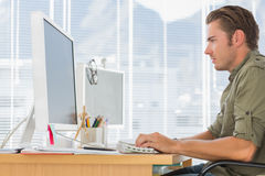 Creative Business Employee Working On Computer Stock Image