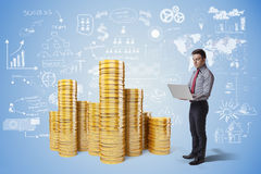 Creative business man and gold coins Royalty Free Stock Photography