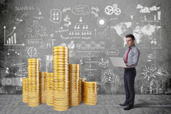 Creative business man and gold coins Stock Photography