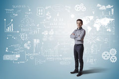 Creative business man standing against business concept background Royalty Free Stock Photos