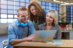Creative business people looking in laptop Royalty Free Stock Photo