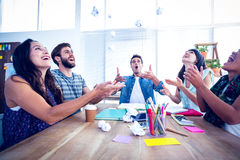 Creative business people throwing paper in the air Royalty Free Stock Image