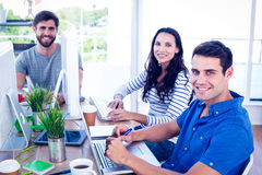 Creative business people using laptop in meeting. At office royalty free stock images