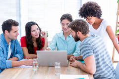Creative business people using laptop in meeting Royalty Free Stock Photography