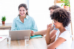 Creative business people using laptop in meeting Stock Images