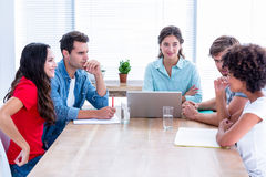 Creative business people using laptop in meeting Stock Photos
