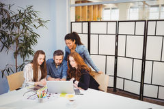 Creative business people using laptop in meeting room Royalty Free Stock Image