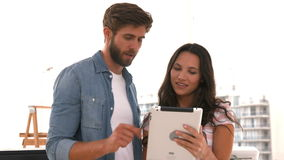 Creative business people using tablet. In the office stock footage