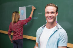 Creative business people at work against blackboard Royalty Free Stock Photo