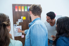 Creative business people at work by blackboard Stock Photography