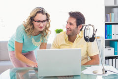 Creative business people working together on computer Royalty Free Stock Photography