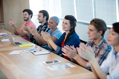 Creative business team applauding in meeting room. At office Royalty Free Stock Images