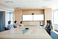 Creative business team attending a video call in conference room. At office stock images