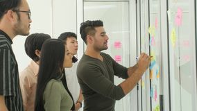 Business team brainstorming ideas with sticky notes