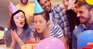 Creative business team celebrating their colleagues birthday. E business team celebrating their colleagues birthday in office stock video