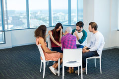 Creative business team consoling upset colleague royalty free stock photos