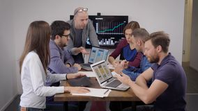 Creative business. A team of developers and designers discussing the layout of a mobile application. Men and women in stock footage