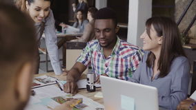 Creative business team discussing architectural project. Brainstorming of mixed race group of people in trendy office. royalty free stock photography