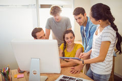 Creative business team gathered around a tablet Royalty Free Stock Photos