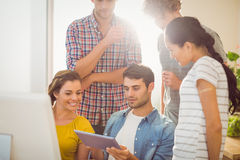 Creative business team gathered around a tablet Royalty Free Stock Photography