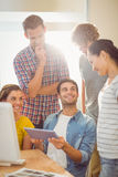 Creative business team gathered around a tablet Royalty Free Stock Photo