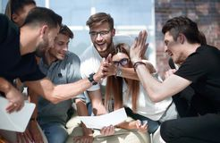 Creative business team gives each other a high five. The concept of teamwork royalty free stock photography